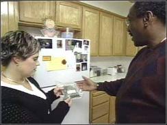 Debbie Jeffries shows Correspondent Harold Dow the bag of marijuana she keeps in her freezer.