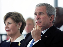 President Bush and wife, Laura, at the christening ceremony for the George H.W. Bush (CVN 77) aircraft carrier in Newport News, Va., Oct. 7, 2006.