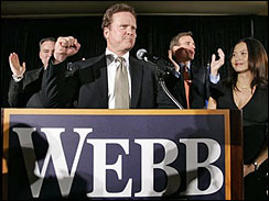 Senate candidate Jim Webb, center, pumps his fist as he is joined by Gov. Tim Kaine, D-Va., left, and former Gov. Mark Warner, D-Va., right, during election night in Vienna, Va.