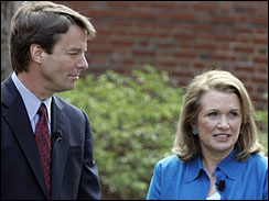 Democratic Presidential hopeful John Edwards, left, listens to his wife Elizabeth speak about her recurrence of cancer
