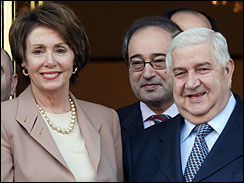 Syrian Foreign Minister Walid al-Moallem, right, stands with U.S. House Speaker Nancy Pelosi in Damascus on Wednesday, April 4, 2007 in Damascus.