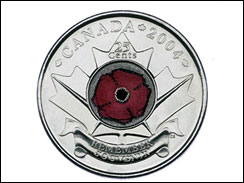 This photo provided by the Royal Canadian Mint shows a 2004 silver-colored 25-cent piece, known as the poppy quarter.