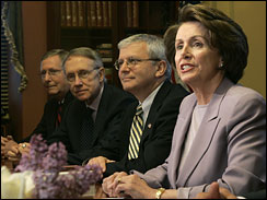 House Speaker Nancy Pelosi, right, makes a statement at the top of  Capitol Hill meeting on Iraq, Friday, May 18, 2007.