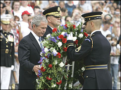 President Bush lays a wreath at the Tomb of the Unknowns at Arlington Nat\'l Cemetery.