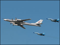Russian strategic bomber TU-95 surrounded by MiG-29