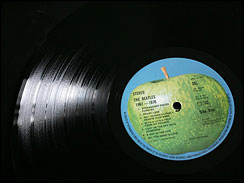 "a vinyl record of the Beatles' album ""Abbey Road."""