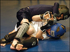 Eli Lindsey, eight, top, spars with Gage Bloomer, eight, during practice at Garage Boys Fight Crew in Carthage, Mo, on Wednesday, March 5, 2008. Lindsey and Bloomer train at the facility in southwest Missouri for ultimate fighting events.