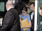 Casey Anthony, mother of missing toddler Caylee Anthony, is escorted from the Orange County Florida jail by her attorney Jose Baez, second from right, after posting a $500,000 dollar bond in Orlando, Fla., on Aug. 21, 2008.