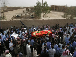 Angry family members and villagers shout anti-American slogans as they carry the coffin of a victim killed in a U.S. military helicopter attack in Syria