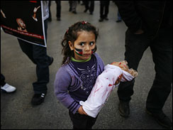 An Israeli Arab girl with the Palestinian flag painted on her face joins thousands of Israeli Arabs protesting against Israel's military operation in Gaza, in the northern Israeli town of Sakhnin