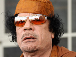 Libyan leader Moammar Gadhafi arrives at the African Union Meeting in Addis Ababa, Feb. 1, 2009. A New Jersey town is protesting Gadhafi's plans to stay there during the U.N. General Assembly next month, in part because of the hero's welcome Pan Am flight 103 bomber Abdel Baset al-Megrahi received upon his return to Libya last week.