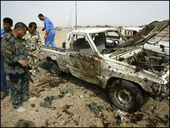 Awakening Council member examine the scene of a suicide bombing in Kirkuk, Iraq, May 21, 2009.