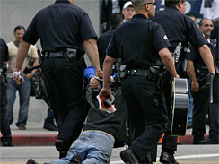 A fan is arrested outside Michael Jackson's public memorial service at the Staples Center in Los Angeles on July 7, 2009.