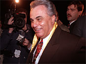 John Gotti, reputed head of the nation's most powerful crime family, leaves the New York FBI in custody after his arrest at his Little Italy social club in New York City, Tuesday night, Dec. 13, 1990. Gotti was named Wednesday in a federal racketeering indictment accusing him of ordering the 1985 murder of his predecessor, Paul Castellano. (AP Photo/Andrew Savulich)