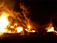 Three fuel tanks burn inside the gasoline warehouse and distribution center of Caribbean Petroleum Corp., owned by Gulf, in Catano, Puerto Rico, early on Oct. 23, 2009.