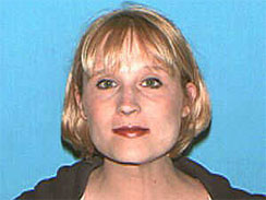 This photo provided by the U.S. Secret Service shows Kristy Lee Roshia. Authorities say Roshia, accused of threatening to kill first lady Michelle Obama, is in federal custody in Honolulu as the Obama family plans to travel to Hawaii.