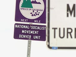 An Adopt-A-Highway sign for the National Socialist Movement, also known as America's Nazi Party, is seen on Highway 85 near Brighton, Colo.