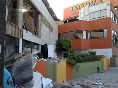 This photo provided by Jorge Rivera  cimarron98 on Twitter  shows structural damage to the Escomex business school building after an earthquake in Mexicali, Mexico, Sunday, April 4, 2010. The 7.2-magnitude quake struck at 3:40 p.m. in Baja California, Mexico, about 19 miles southeast of Mexicali, according to the U.S. Geological Survey.