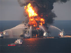 This image provided by the U.S. Coast Guard shows fire boat  response crews battle the blazing remnants of the off shore oil rig  Deepwater Horizon, April 21, 2010.