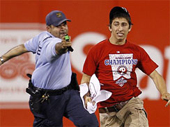 Officer aims Taser gun at fan who ran onto field at PHillies game 