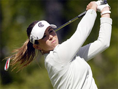 In this May 23, 2008, file photo, Erica Blasberg tees off on the seventh hole during the second round of the LPGA Corning Classic golf tournament in Corning, N.Y.