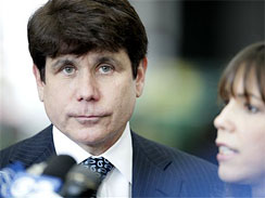 In this file photo, Former Ill. Gov. Rod Blagojevich and his wife arrive at the Federal Court building in Chicago. A racetrack owner testified Monday at Blagojevich's corruption trial that he was pressured to donate to the then-governor's campaign.