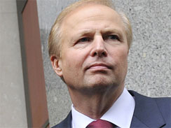 Incoming CEO Bob Dudley poses outside BP's global headquarters in London, Tuesday, July 27, 2010.