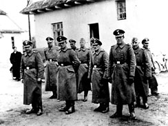 This photo made available by Yad Vashem Photo Archive in Jerusalem shows Nazi guards at Belzec death camp in occupied Poland in 1942. A former Nazi death camp guard has been charged with participating in the murder of 430,000 Jews and other crimes during the Third Reich.