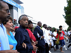 The Rev. Al Sharpton, third from left, and others march through Washington Aug. 28, 2010, the 47th anniversary of Martin Luther King Jr.'s _I Have a Dream_ speech.