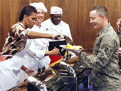 image7044082g First Lady Surprises Group of Service Men and Women at Ramstein Air Base by Helping Serve Steaks at Special Veterans Day Meal