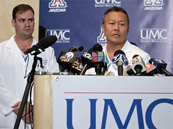 Dr. Peter Rhee, right, speaks about the condition of U.S. Rep. Gabrielle Giffords, D-Ariz., as Dr. G. Michael Lemole, Jr., looks on at University Medical Center during a news conference in Tucson, Ariz., Sunday, Jan. 9, 2011.