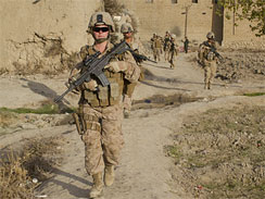 Lance Corporal Kristi Baker, 21, U.S. Marine with the FET (Female Engagement Team) 1st Battalion 8th Marines, Regimental Combat team II patrols with other Marines on November 20, 2010 in Musa Qala, Afghanistan.