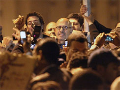 Egyptian dissident Mohamed ElBaradei attends a demonstration in Tahrir Square in Cairo, January 30, 2011, where he told thousands that they were _beginning a new era._