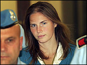 American murder suspect Amanda Knox is escorted Sept. 26, 2008, by Italian penitentiary police officers from Perugia's court after a hearing in central Italy.
