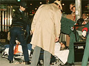 The body of mafia crime boss Paul Castellano lies on a stretcher outside the Sparks Steak House in New York after he and his bodyguards were gunned down Dec. 16, 1985. Mobster John Gotti claimed the top spot in the Gambino family following the gangland shooting. (AP Photo/Mario Suriani)