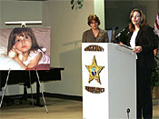 Joyce Dawley, left, of the Florida Division of Law Enforcement listens as Medical Examiner Dr. Jan Garavaglia announces that she has ruled the death or Caylee Anthony, shown in photo at left, a homicide after the bones found earlier were positively identified as that of the missing girl during a press conference in Orlando, Fla., Friday, Dec. 19, 2008. (AP Photo/Reinhold Matay)